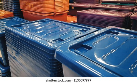 Group of Stacked Plastic Boxes with Lids at Store