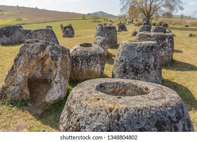 A group of stone jars at the Plain of Jars, Thong Hai Hin Site 1, at Thomghaihin near the town of Phonsavan in the province Xieng Khuang in Laos in Southeastasia.