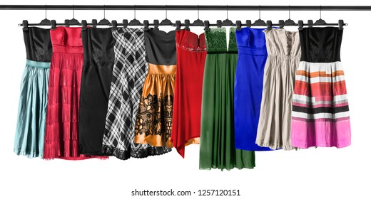 Group of strapless dresses hanging on clothes racks on white background