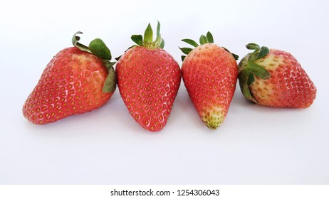 a group of strawberries against white background