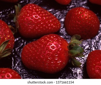 Group of Strawberries on a texture vinyl.
