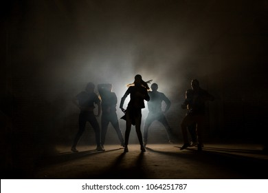 a group of street dancers performing different moves on the dark street. love dancing