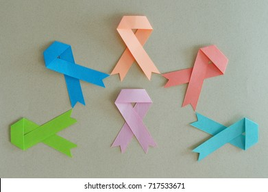 Group of strips of breast cancer, lymphoma, uterine, leukemia, colon and prostate, made in paper with beige background.