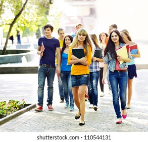 Group student with notebook on outdoor.