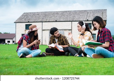 Group of student through the park after class. Enjoy talking together.