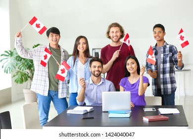 Group of students with Canadian flags in classroom