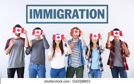 Group of students with Canadian flags and word IMMIGRATION on light background