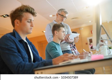 Group of students in computing class with teacher