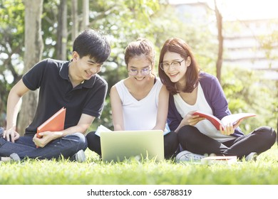 Group of students doing report and home work outdoor in university.