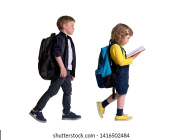 Group of students go back to school. School kids reading book for education. Girl and boy with backpack and book.