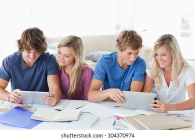 A group of students helping each other out with homework