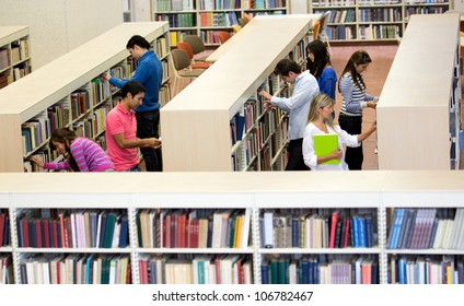 Group of students at the library looking for books