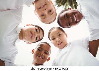 Group of students looking at camera on school grounds