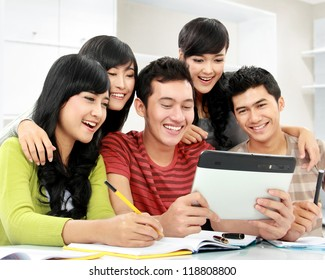 Group of students looking at tablet pc together