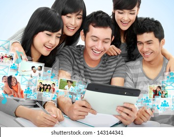Group of students looking at tablet PC together. conceptual image