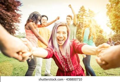 Group of students making party in the park, follow me stance invitation