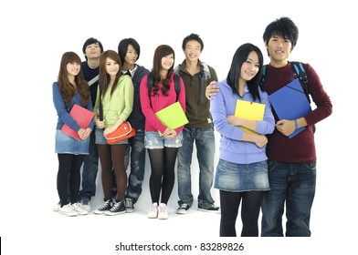 Group Of students with notebooks and paper folders posing--focus on couple standing young Friend