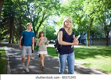 Group of students on their way to class walking through campus