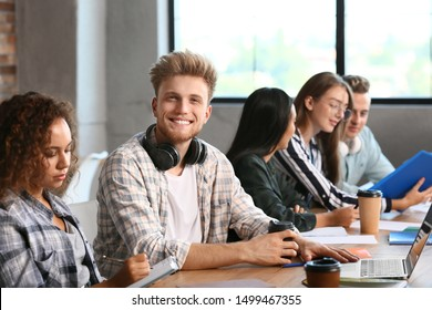 Group of students preparing for exam in university