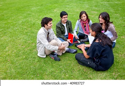 Group of students sitting in a circle outdoors
