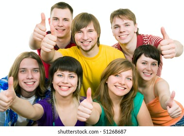Group of students smiling and doing a thumbs up sign