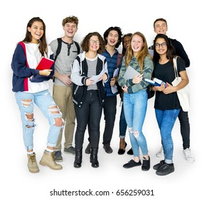 Group of students smiling and standing together