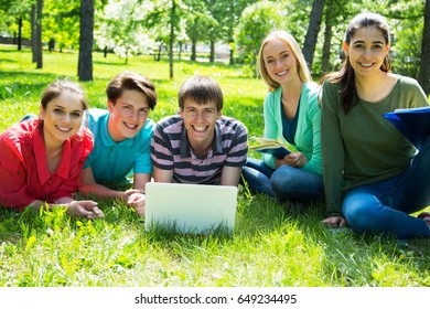Group of students studying together in campus ground