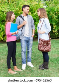 Group of students talking in a park
