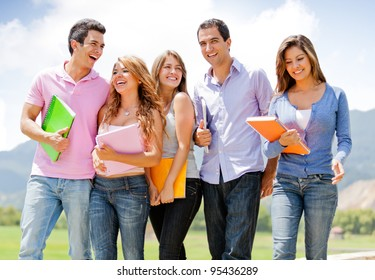 Group of students talking a walk outdoors and smiling