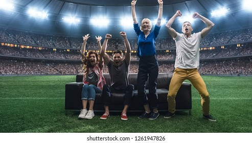 Group of students are watching a football moment, sitting on the couch located in the middle of the football stadium. Stadium and crowd are made in 3D.