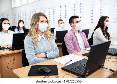 Group of students wearing protection masks in class, prevention concept