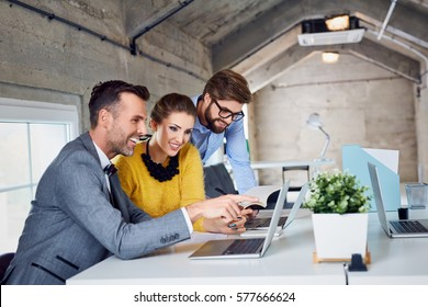 Group of stylish business people working together at modern office