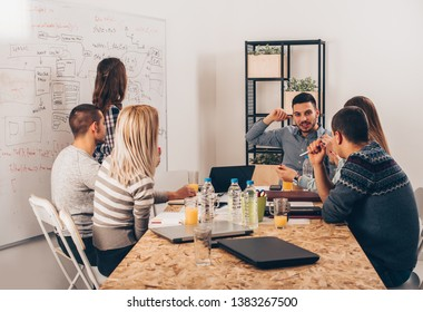 Group of succesfull people are discussing indoors