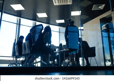 a group of successful afro americans, europeans ,arabic and korean businessman and businesswoman working in the office with large glass windows