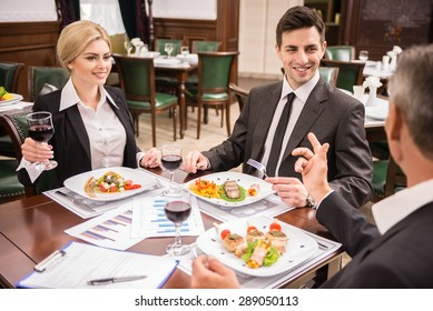 Group of successful business people celebrating a great deal agreement.