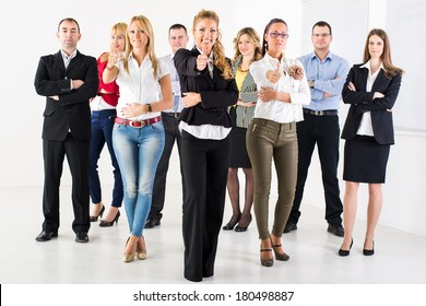 Group of a Successful Business People Showing Thumbs Up and looking at the camera.