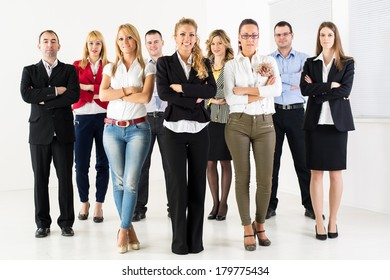 Group of a Successful Business People standing together with arm crossed and looking at the camera.