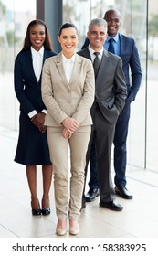 group of successful businesspeople standing in office