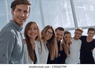group of successful young people standing in the office