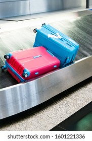 Group of suitcases on conveyor belt of airport.