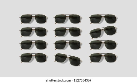 Group of sunglasses put in rows on flat surface