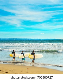 Group of surfers going to surf on the beach. Bali island, Indonesia