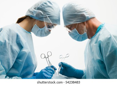 Group of surgeons during their work