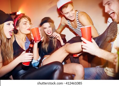 Group of swag people relaxing in night club