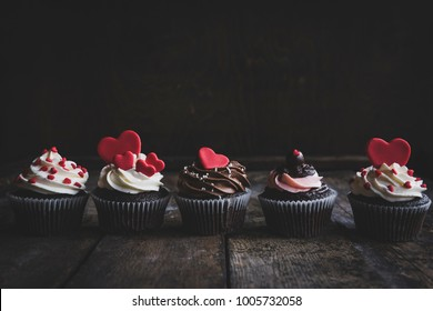 Group of sweet cupcakws with hearts on the top,,valentines day concept and selrctive focus