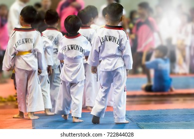 Group of Taekwondo Kids in the stadiums. Moment of Athlete to warm up for strike an opponent during the tournament taekwondo kids