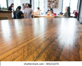 Group talking business in coffee shop selective focusing at wooden table