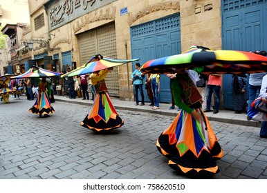A group of Tannoura Egyptian traditional dancers dancing the street of Moez during the annual drums festival in Cairo,Egypt : April 2017