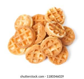 Group of tasty round mini waffles isolated on white background