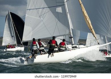 group team skipper sailing on yacht at regatta